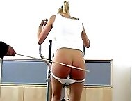 Knickers down caning on her delightful bare bottom - hot stripes and welts