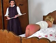 The headmistress is tired of Kellys lazy ways and wakes her up with a few spanks with her cane.  The headmistress orders Kelly on all fours, lifts up