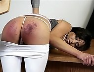 Brunette gets spanked by paddle on her ass!