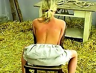 Karin holds onto the chair with all of her might as her naked back is whipped into submission