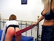 Leather clad bitch gags and straps pretty girl in tears - belted black and blue buttocks