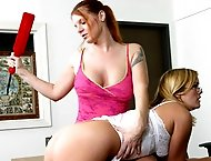 Huge breast red head teacher uses red wooden paddle on her blond student ass