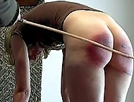 Cute blonde`s ass ripped up by brutal caning